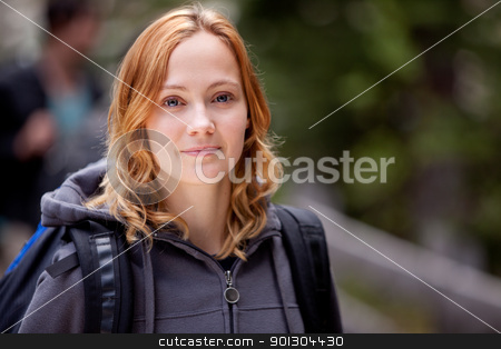 Happy Camper stock photo, A happy woman camper on a hike in the forest by Tyler Olson