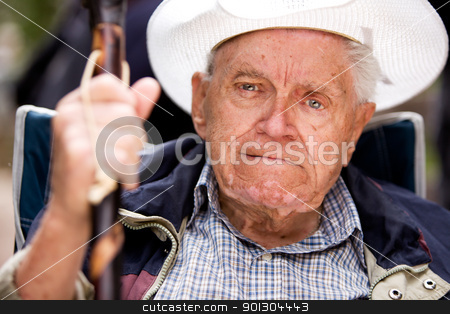 Grumpy Old Man stock photo, A portrait of a grumpy old man sitting in a chair by Tyler Olson