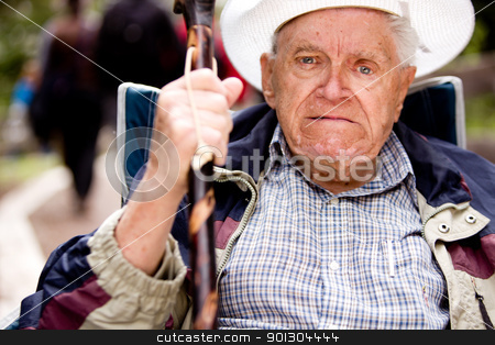 Angry Old Man stock photo, An angry old man with his fist up and unhappy face by Tyler Olson