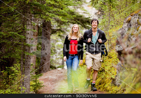 Camping  Hiking Man and Woman stock photo, A happy man and woman hiking on a camping trip by Tyler Olson