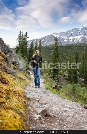 Woman on Trail stock photo, A woman walking on a mountain trail by Tyler Olson
