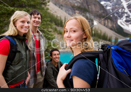 Hiking Friends Outdoor stock photo, A group of friends hiking with a mountain landscape in the background by Tyler Olson