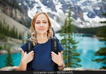 Female hiker with her backpack against scenic view stock photo, Portrait of attractive female hiker with her backpack against scenic view by Tyler Olson