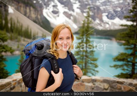 Portrait in Mountain Landscape stock photo, A portrait of a young happy woman infront of a beautiful mountain landscape by Tyler Olson