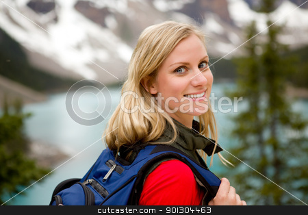 Active Woman Portrait stock photo, A portrait of a pretty woman in front of a mountain landscape, Lake Moraine, Alberta, Canada by Tyler Olson