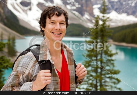 Mountain Hike Portrait stock photo, A portrait of a smiling young male at Lake Moraine, Alberta, Canada by Tyler Olson