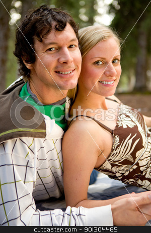 Camping Couple Relax stock photo, An outdoor portrait of a happy couple on a camping trip by Tyler Olson