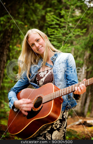 Hippy Woman with Guitar stock photo, A happy pretty woman with a guitar by Tyler Olson