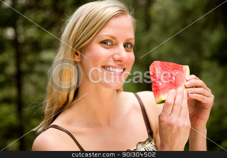 Similing Woman with Watermelon stock photo, A portrait of a blonde woman eating a watermelon by Tyler Olson