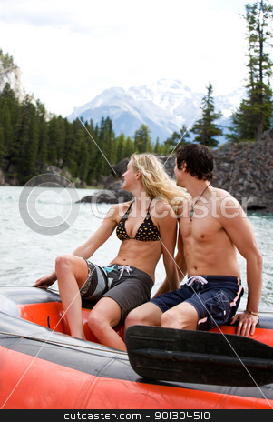 River Rafting stock photo, A happy excited couple on a river raft by Tyler Olson