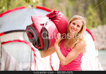 Woman with Sleeping Bag stock photo, A portrait of a woman holding a sleeping bag by Tyler Olson