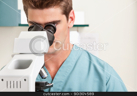 Medical or scientific researcher stock photo, Closeup of young male doctor viewing through microscope by Tyler Olson