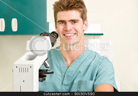 Doctor with Microscope  stock photo, A doctor looking through a microscope by Tyler Olson