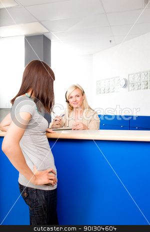 Medical Recption and Patient stock photo, A patient talking to a medical receptionist by Tyler Olson