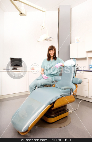 Dental Chair stock photo, A dental hygienist sitting at a dental chair in a clinic by Tyler Olson