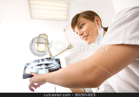 X-Ray Dentist stock photo, A dentist showing an x-ray of adult teeth by Tyler Olson