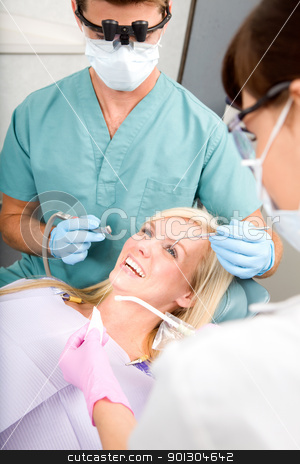 Dentist Patient stock photo, A woman at the dentist about to have some drilling done by Tyler Olson