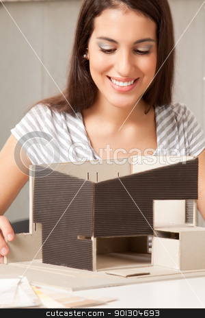 Design Student stock photo, A young design student or architect building a house model by Tyler Olson