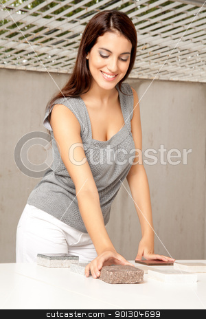 Designer with Stone Sample stock photo, An architect or designer with stone / flooring samples by Tyler Olson