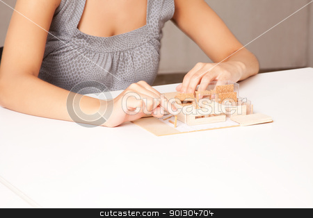 Interior Designer Detail stock photo, A detail of a interior designer working on a model house by Tyler Olson