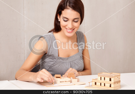Interior Designer stock photo, A female interior designer working on a scale model by Tyler Olson