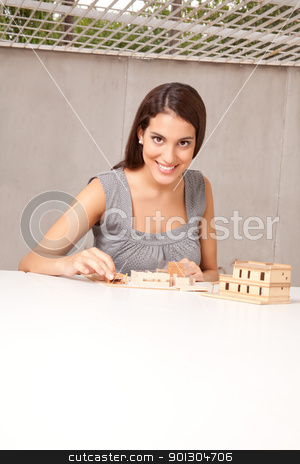 Woman Architect Design stock photo, A female architect / designer working on a rough house model by Tyler Olson