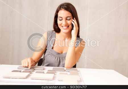 Architect Design Tile stock photo, An architect / designer talking on the phone choosing a stone tile by Tyler Olson