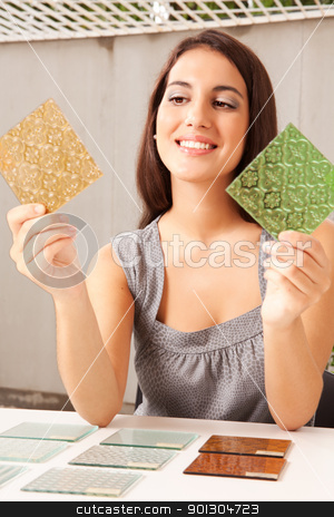 Glass Tile Design Choice stock photo, An interior architect / designer choosing a glass tile by Tyler Olson
