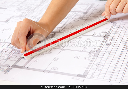 Scale Ruler on Blueprints stock photo, Two hands using a scale ruler on a set of blueprints by Tyler Olson