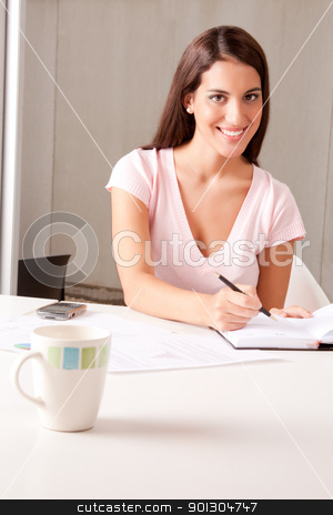 Woman in Business Meeting stock photo, A young attractive woman in a business meeting by Tyler Olson