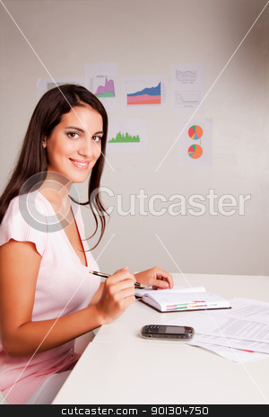 Casual Business Woman stock photo, A casual business woman with a day timer by Tyler Olson