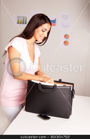 Happy Prepared Business Woman stock photo, A happy smiling business woman presents some documents by Tyler Olson