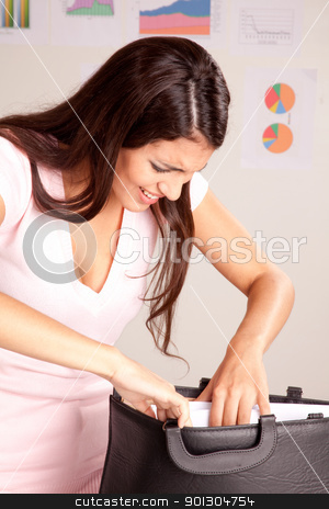 Stressed Business Woman stock photo, A stress forgetful business woman looking in her briefcase by Tyler Olson