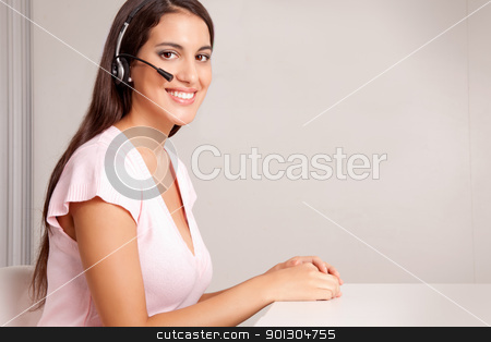 Help Desk Call Center stock photo, A female on a hands free phone - friendly call center by Tyler Olson