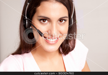 Call Center Receptionist stock photo, A female receptionist smiling at the viewer talking on the phone by Tyler Olson