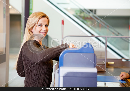 Portrait of a young woman smiling after shopping stock photo, Portrait of a young woman smiling after shopping at supermarket by Tyler Olson