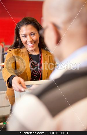 Store Pay Card stock photo, Passing over credit card to shop assistant after shopping by Tyler Olson