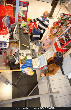 Shop assistant with customer stock photo, High angle view of shop assistant with customer in supermarket by Tyler Olson