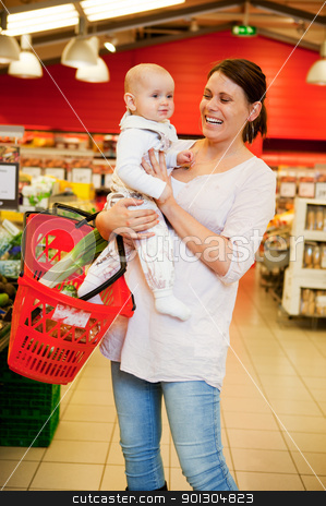 Grocery Store Baby stock photo, A mother with baby daughter in a grocery store by Tyler Olson