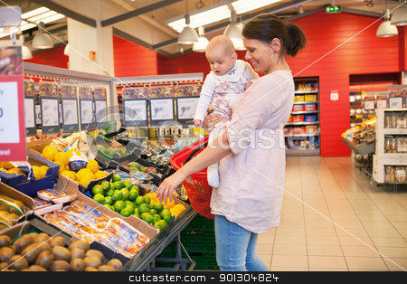 Mother and child shopping stock photo, Mother and child shopping in supermarket by Tyler Olson