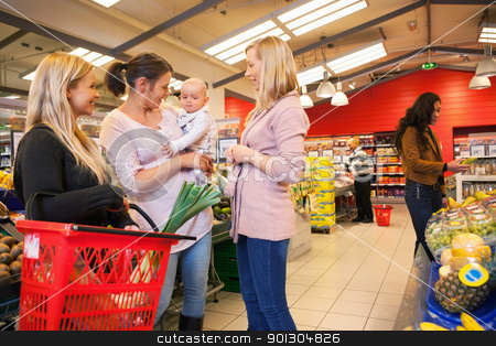 Mother carrying child with friends shopping stock photo, Mother carrying child with friends shopping in supermarket by Tyler Olson