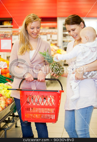 Two Friends Buying Groceries with Baby stock photo, Two friends in grocery store buying groceries with baby by Tyler Olson