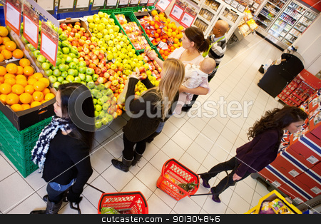 Busy Grocery Store stock photo, High angle view of busy people shopping in supermarket by Tyler Olson
