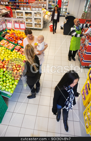 Busy Supermarket stock photo, High angle view of people buying in supermarket by Tyler Olson