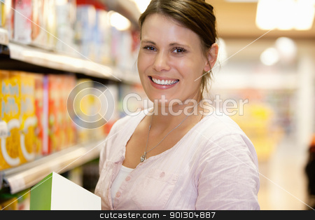 Supermarket Portrait Woman stock photo, Close-up of a shopper in shopping centre smiling and looking at camera by Tyler Olson