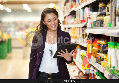 Woman looking at digital tablet in shopping store stock photo, Cheerful young woman looking at digital tablet in shopping store by Tyler Olson