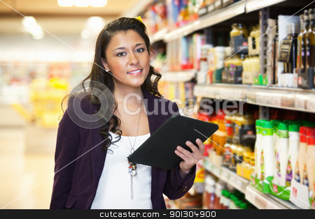 Woman Shopping with Digital Tablet stock photo, Smiling young woman looking at camera while holding digital tablet in shopping centre by Tyler Olson