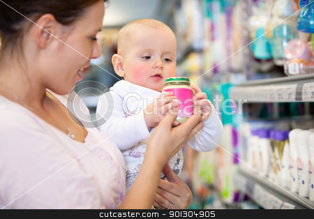 Mother with Baby in Supermarket stock photo, Mother shopping with baby in a supermarket, shallow depth of field - focus on baby by Tyler Olson
