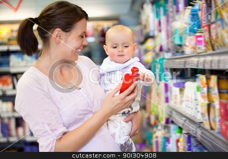 Mother Shopping with Baby in Supermarket stock photo, Cheerful mother playing with baby and spending time in shopping store by Tyler Olson