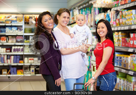 Happy Friends in Grocery Store stock photo, Woman holding baby and standing with friends while looking at camera in shopping centre by Tyler Olson